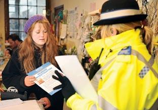 Community support officers hand out appeals for information on Betty Yates' murder to Bewdley shoppers.