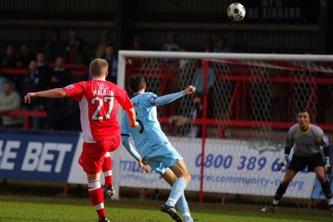 Super-strike: Antony Malbon scores for Harriers. Picture: ADRIAN HOSKINS