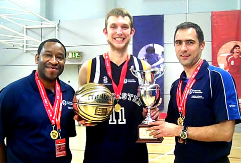 CHAMPIONS: University director of basketball Paul James, Tommy Freeman and coach Alex Radu with their BUCS trophies.