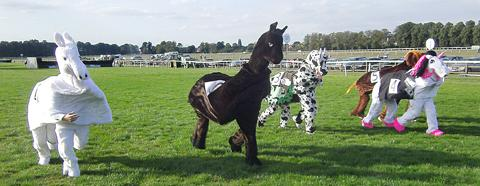 NAGS: Pantomime horses gallop to the finish in