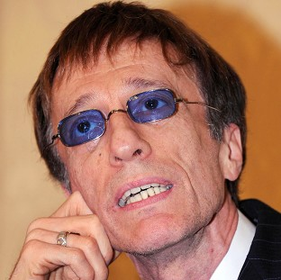 Bee Gees star Robin Gibb fell into a coma last week after contracting pneumonia in his