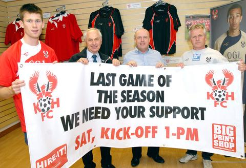 Getting the message across: Assistant manager Gary Whild (right), midfielder Dave Hankin (left) and directors John Davies (inside left) and Gino Ruffinato (inside right) hold up a banner urging fans to attend Harriers' must-win clash against Mansfield.