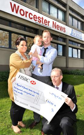 fund-raising: Nigel Wilson presents a cheque for Ronald McDonald House to Chris and Lorna Wyse and their daughter Jovie. Picture by John Anyon. 16016602