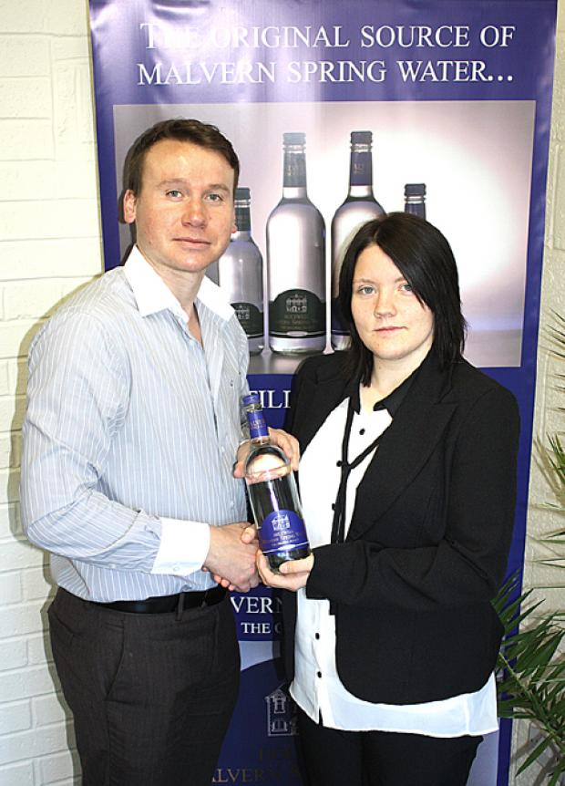 SKILLS: Rhys Humm, director of Holywell Water, with new apprentice Shannon Brimmell.
