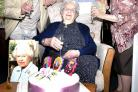 CHEERS: Gladys Slack celebrates her 105th birthday with son Stuart Slack, home manager Andrew Darwent and daughter-in-law Pat Slack.