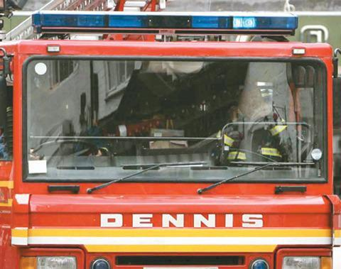 Firefighters were called after smoke was seen pouring from the garage