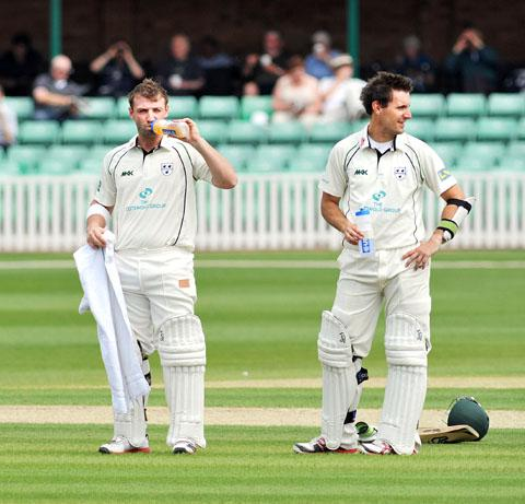 TAKE-A-BREAK: Worcestershire openers Phil Hughes (left) and captain Daryl Mitchell enjoy a drink as they pile on the runs against Somerset.