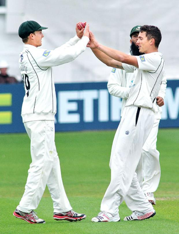 HIGH FIVES: Richard Jones (right) congratulates Matt Pardoe after taking the catch of Arul Suppiah.