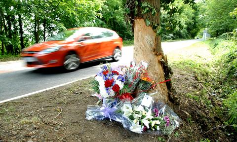 TRAGEDY: Floral tributes at the crash site (23058603)