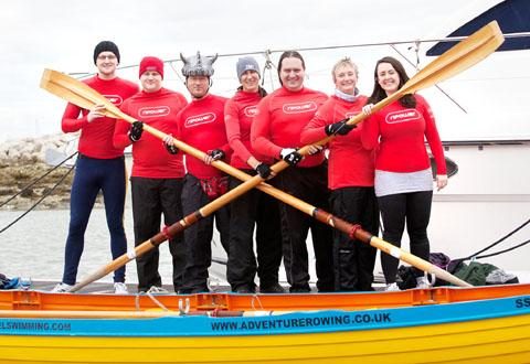 SQUAD: Rob Webb with the RWE npower team, who hope to row across the English Channel for charity.