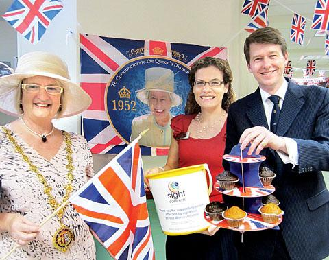 TEA FOR THREE: From the left, Mayor of Droitwich Anne Taft, chief officer of Sight Concern Jenny Gage,  and Worcester MP Robin Walker.
