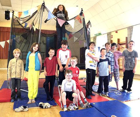 TRAMPOLINE: Children take a break from their sponsored bounce.