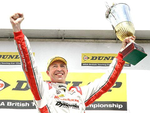BACK ON TOP: Matt Neal celebrates his win in race one. Picture: DARREN PRICE