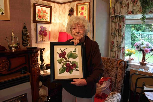 Edith Haering, 87, shows off one of her paintings