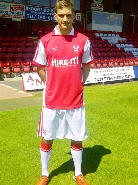 Going Dutch: Mickey Demetriou shows off the new Harriers home kit.