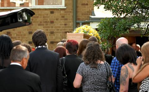 SOMBRE: Mourners follow Christell O'Shea's coffin in to the church (31102601)