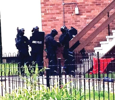 DRAMA: Armed police in Malvern