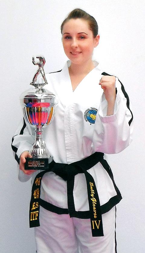 INSPIRED: Sally Gleaves received her fourth-degree black belt.