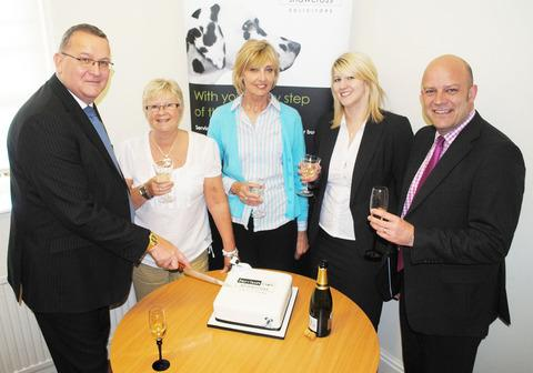 CHEERS: Partner Andrew Perrett, secretary Michele Williams, secretary Sandi Brain, solicitor Carly Shaw and partner and head of the Harrison Clark Shawcross office, Andrew Caldicott.