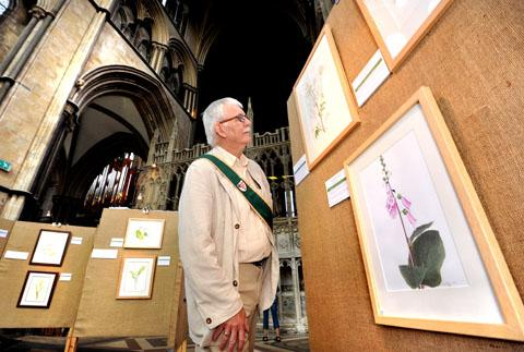 ON SHOW: Welcomer Glenn Scott looks at the exhibits.