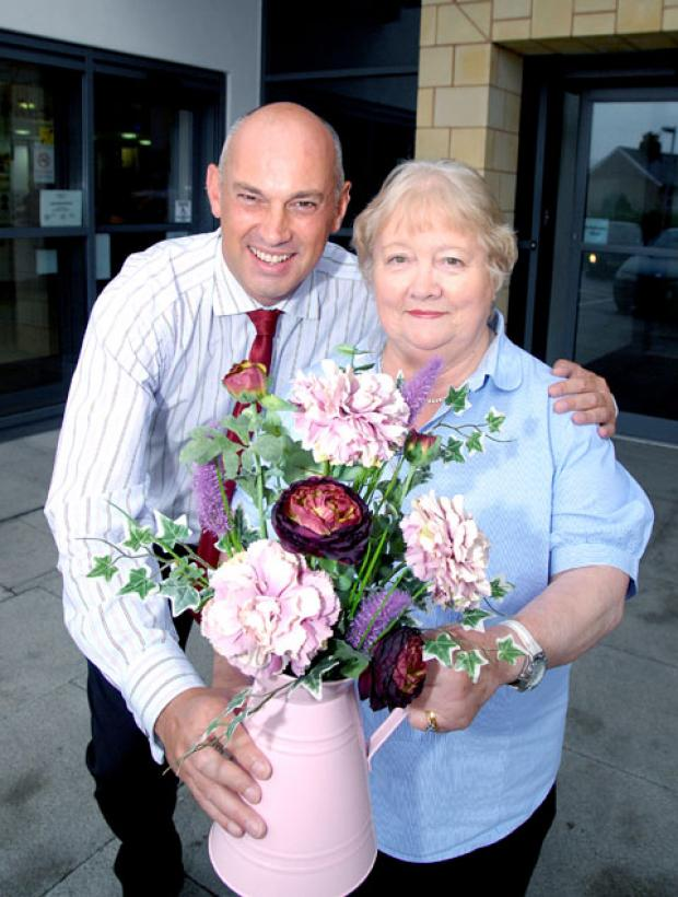 GOODBYE: Prospect View practice manager Clive Fenney has flowers for nurse of 32 years Mary Knock. 35120701.