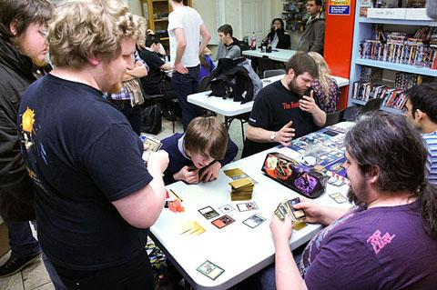 CARD SHARP: Players considering their options at city centre hobby games tournament shop Manaleak.com