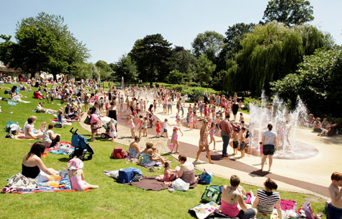 BUSY AND HAPPY: Hundreds of people at the Splashpad earlier in the summer.