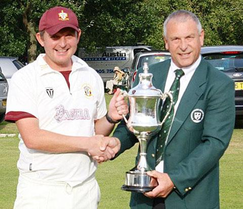 CHAMPIONS: Worcester Nomads captain Ben Schiffmann receives the Worcestershire League's Division One trophy from chairman Peter Radburn.