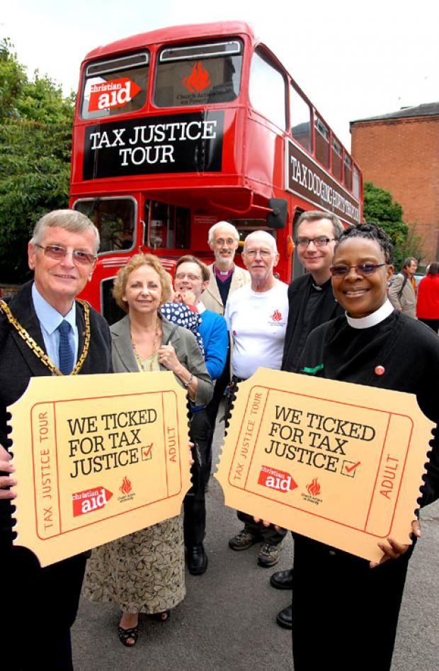 The Poverty Tax bus into Worcester with the city's Mayor, Councillor Roger Berry and Mayoress Jill Berry; Green Party councillor Neil Laurenson; the Rt Rev David Walker, Bishop of Dudley; Cyril Bezant, the Rev Christopher Stuart and Suzanne Matale.