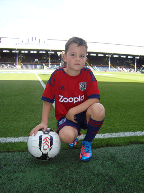 ON THE BALL: Charlie Miles on the pitch at Cravan Cottage during his dream day as a mascot for West Brom.