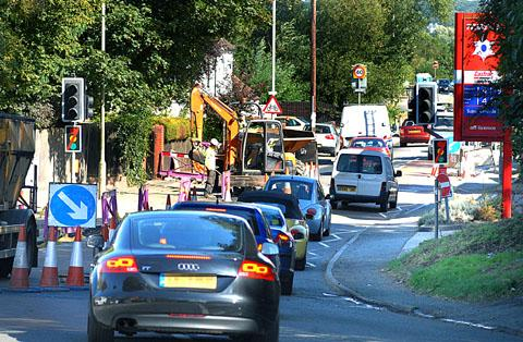 TAILBACKS: Traffic slowly makes it way past roadworks carried out by National Grid on the A449 through Powick.