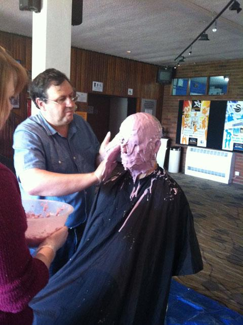 Special effect: Steve Chambers, left, gets to work on a prosthetic mould of Ian Kier Attard's head