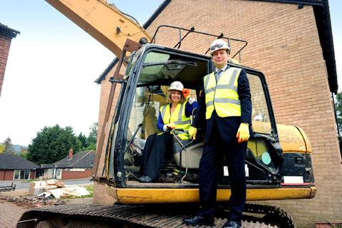 IN CONTROL: Harriett Baldwin and Guy Weston start demolition work on the site of the new development.