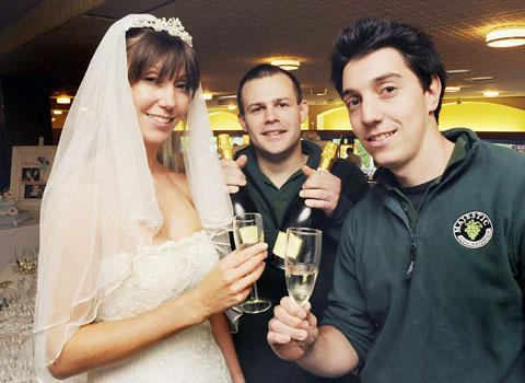 RAISING A GLASS: Fiona Deakin, of the Bridal Gallery in Malvern,  with Paul Roper and Aaron Apperley, of Majestic Wines, at the event.