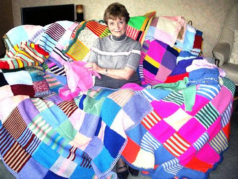 APPEAL: Joan Gibson shows how Malvern's Inner Wheel club turn donated wool into blankets and jumpers for children.