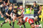 TOUGH: Loosehead prop Matt Mullan (centre) has been hailed by Warriors skipper Dean Schofield after a solid display in their side's 35-11 home win over London Irish.
