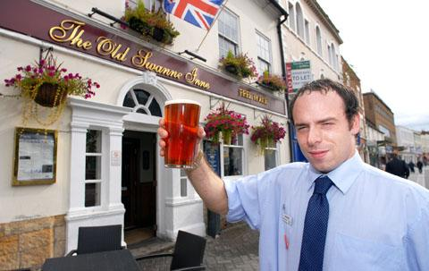 SUCCESS: New landlord Laurence Goodwin toasts his pub's success.