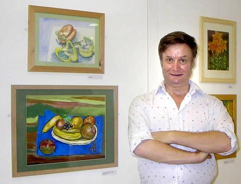 PLENTY TO ADMIRE: Steven Jew with some of the art.