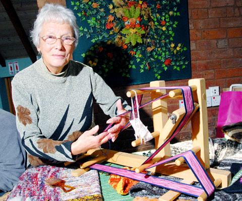 OLD SKILLS: Betty Ballard on an inkle loom at the Earth Fest, held at the Fold, Bransford.