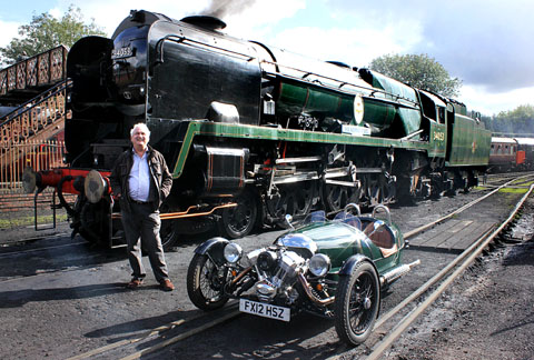 RACE IS ON: John Leftwich of Severn Valley Railway Charitable Trust next to the steam train and the Morgan 3 Wheeler