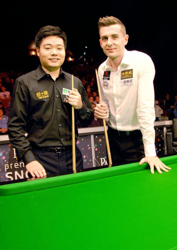 STARS ON STAGE: Ding Junhui (left) and Mark Selby ahead of their PartyPoker.com Premier League match at Malvern Theatres. The Chinese ace won 4-2.