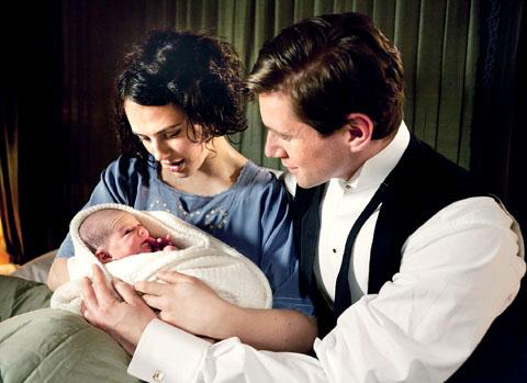 TENDER MOMENT: Lady Sybil Crawley with husband Tom Branson and her baby girl in Downton Abbey shortly before her death