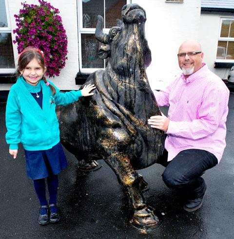 BULL BY THE HORNS: Grace Kasch, aged six, with Andy Probyn and Dillon (41150703)