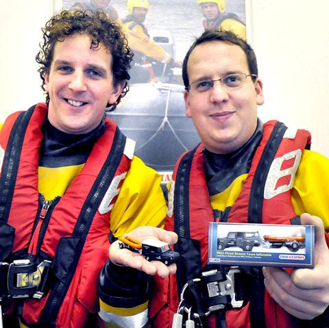 ALL ABOARD: RNLI members Tim Walters, left, and Ashley Chappell with the models
