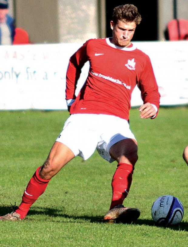 SPEEDING: Deaf footballer Jamie Clarke on the pitch.