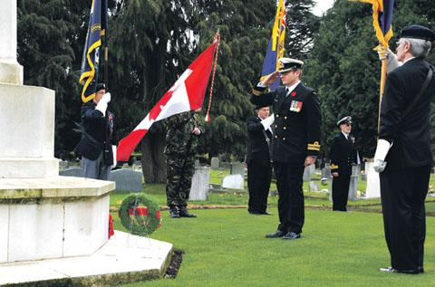 TRIBUTE: Lieutenant Commander Jasen Webster, representing Canadian forces, lays a wreath at yesterday's S