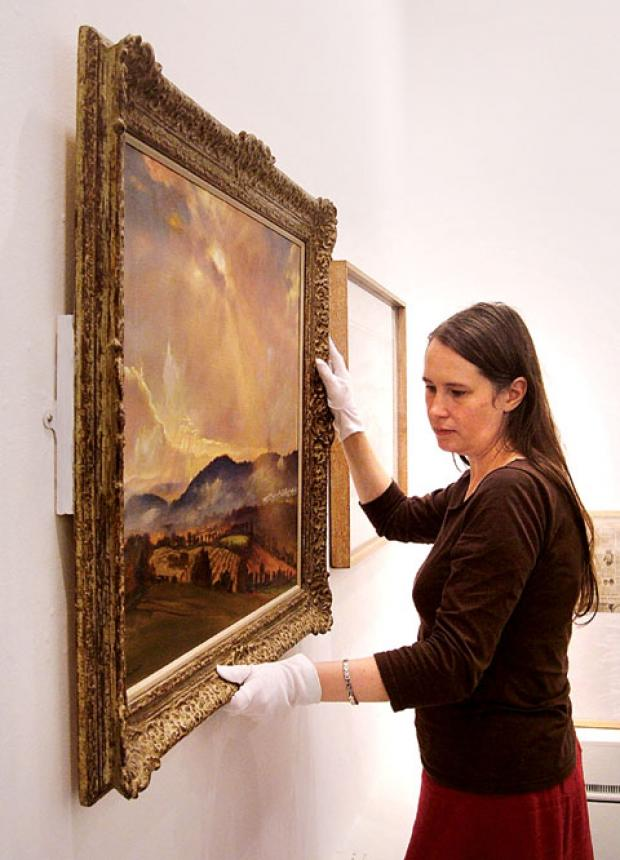 GETTING READY: Philippa Tinsley, senior curator for Museums Worcestershire, at work to install the Laura Knight exhibition.