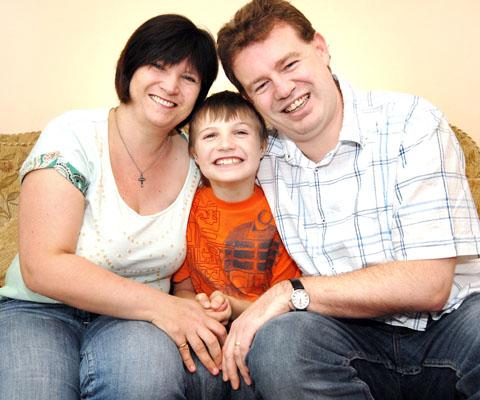 family: Julie Price pictured with her husband Jim and their son Callum in 2008. 42048101