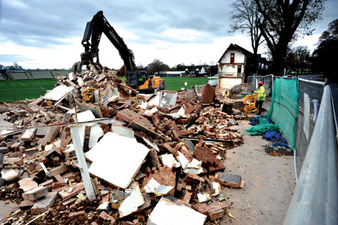BRINGING THE HOUSE DOWN: Demolition work goes on at Worcestershire's New Road ground.