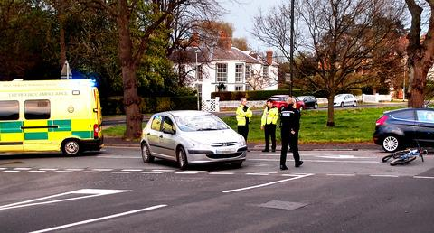 ACCIDENT: Emergency services at the scene after the police officer was knocked off his bike. Picture by Brian Metcalf.